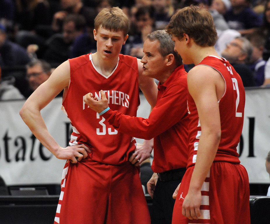 . Lakeville North head coach John Oxton makes a point with JP Macura, left, and Calven Pesola late in the second half. (Pioneer Press: Scott Takushi)