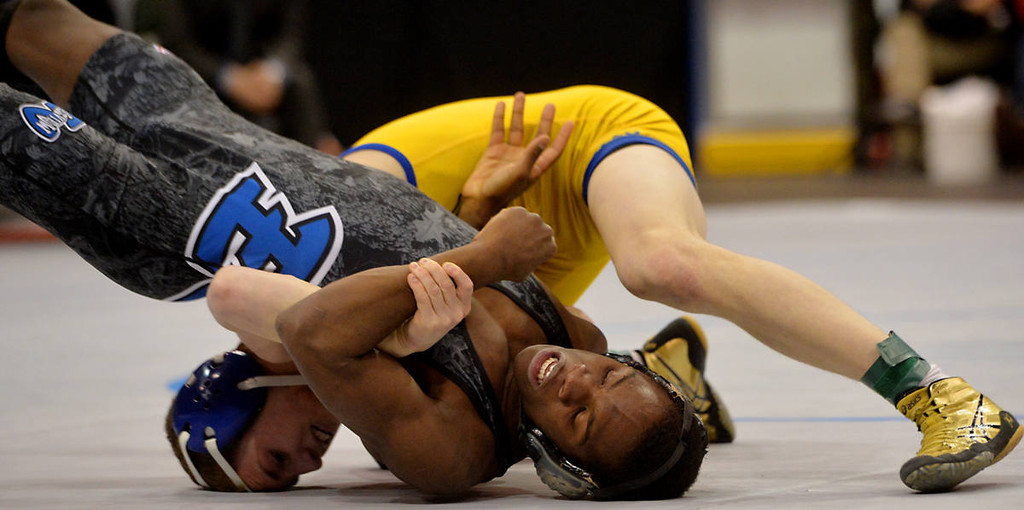 . St. Michael-Albertville senior Tommy Thorn flips Eastview junior George Farmah during the class AAA 126 pound State Wrestling Championship at the Xcel Energy Center in St. Paul , Saturday, March 1, 2014. Thorn would claim the title on a 12-0 decision. (Pioneer Press: John Autey)