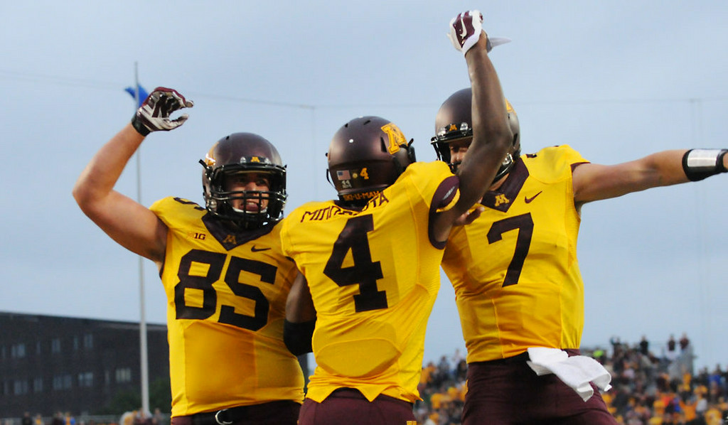 . Minnesota wide receiver Donovahn Jones, center, jumps up to celebrate his 36-yard touchdown catch against Eastern Illinois with quarterback Mitch Leidner, right, and tight end Lincoln Plsek in the second quarter.  (Pioneer Press: John Autey)