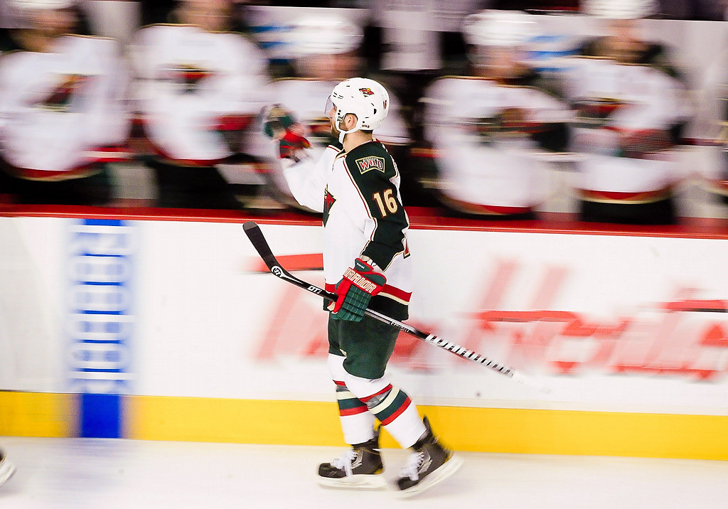 . Minnesota Wild left wing Jason Zucker skates past the bench after Marco Scandella scored in the third period. (Pioneer Press: Ben Garvin)