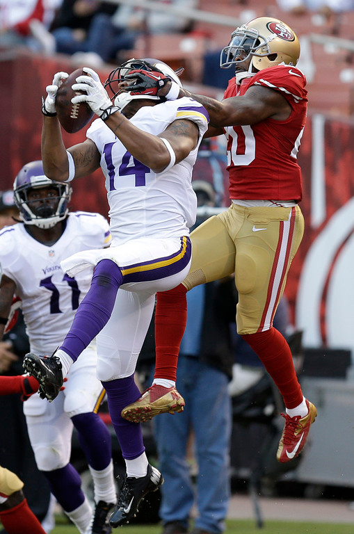 . Vikings wide receiver Joe Webb leaps in front of 49ers defensive back Perrish Cox to nab a three-yard touchdown pass during the third quarter. (AP Photo/Ben Margot)