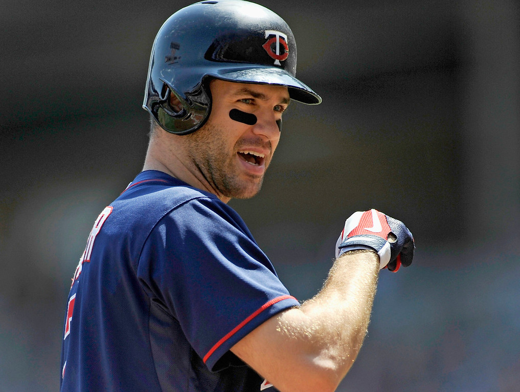 . Minnesota\'s Joe Mauer reacts to striking out against Cleveland starter Justin Masterson during the first inning. Mauer went hitless in four trips to the plate, including two strikeouts. (Photo by Hannah Foslien/Getty Images)