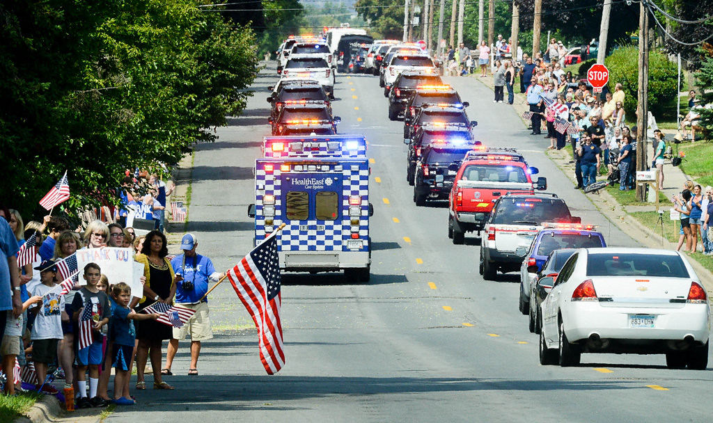 . The funeral procession heads north on Charlton Street after leaving St. Stephen\'s. (Pioneer Press: Ben Garvin)
