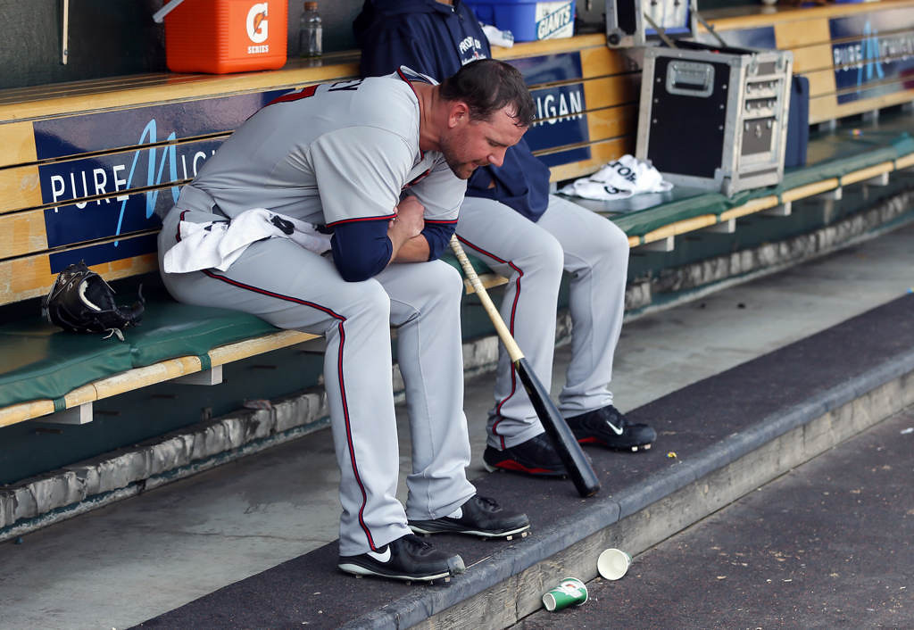. Minnesota Twins starting pitcher Mike Pelfrey sits in the dugout after being pulled during the sixth inning of a baseball game against the Detroit Tigers in Detroit, Sunday, May 26, 2013. (AP Photo/Carlos Osorio)