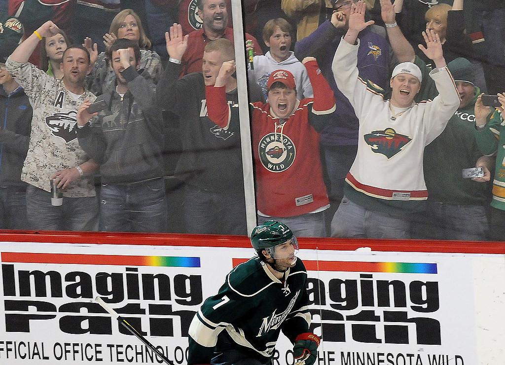 . Wild fans go crazy at the glass after Minnesota Wild center Matt Cullen (7), bottom, scored the winning goal during a shootout. (Pioneer Press: Sherri LaRose-Chiglo)