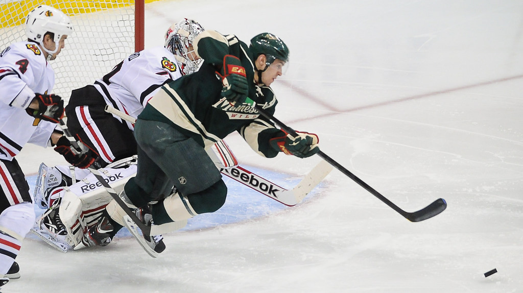 . Minnesota left wing Zach Parise chases after a loose pick near the Chicago net in the third period. (Pioneer Press: Ben Garvin)