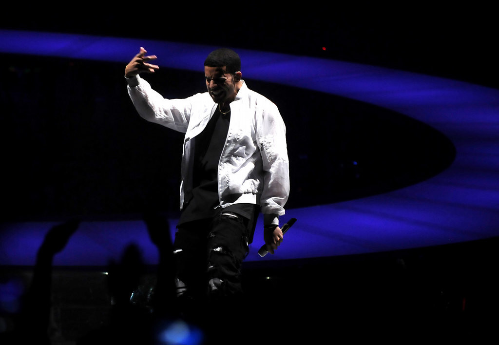 . Rapper Drake performs his first song of the night at the Target Center on  Sunday, December 8, 2013 in Minneapolis. The Canadian recording artist, rapper, songwriter, and actor was born in Toronto, Ontario.(Pioneer Press: Sherri LaRose-Chiglo)