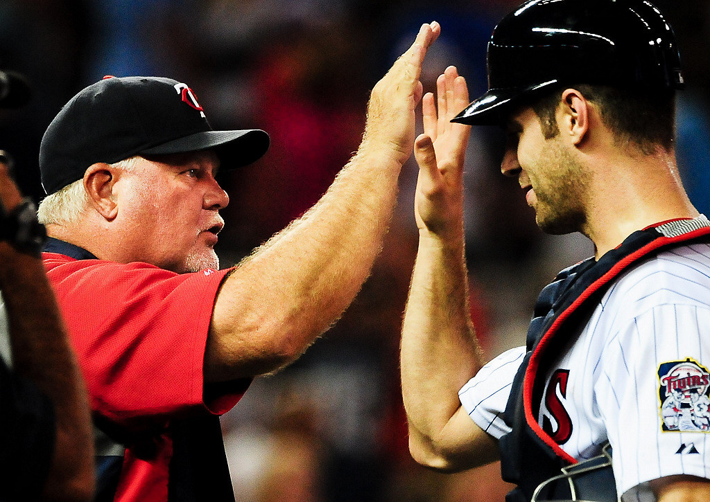 . Minnesota Twins manager Ron Gardenhire greets Joe Mauer after their 3-2 win over the Cleveland Indians. (Pioneer Press: Ben Garvin)