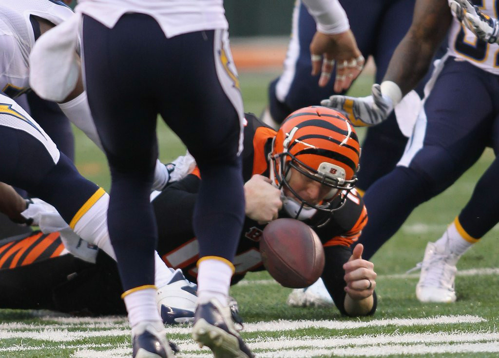 ". <p><b> CINCINNATI BENGALS</b> </p><p><i>�Orange You Unsightly�</i> </p><p>I feel for the redhead named Dalton </p><p>That the Who Dey-ing fanboys keep faultin� </p><p>But their annual demise </p><p>To my own two eyes </p><p>Are the clownish suits worn by their guys <br></p><p>PREDICTION: <b>11-5 � First place in AFC North </b> </p><p><b><a href=""http://bostonherald.com/sports/columnists/ron_borges/2014/01/after_dismal_game_cincy_s_andy_dalton_fails_to_accept\"" target=\""_blank\""> LINK </a></b> </p><p>    (John Grieshop/Getty Images)</p>"