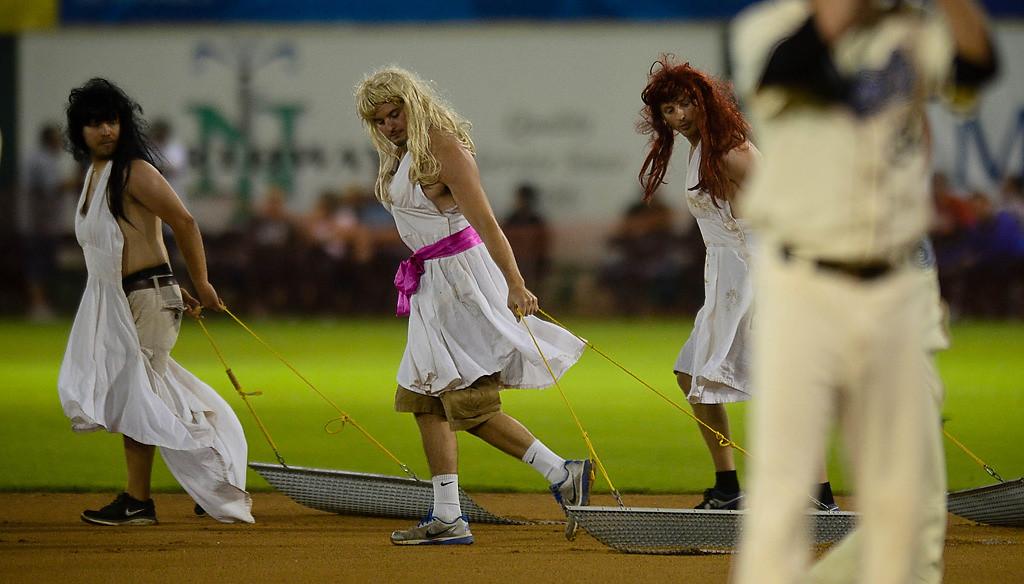 """. The grounds crew \""""drags\"""" the field between innings. (Pioneer Press: Ben Garvin)"""