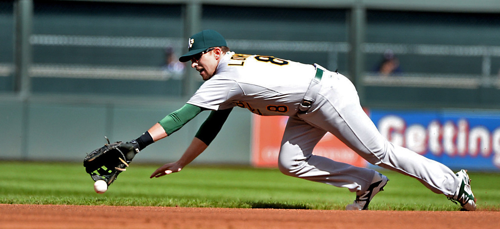 . Oakland shortstop Jed Lowrie can\'t catch up with Chris Colabello\'s first inning single to left field. (Pioneer Press: John Autey)