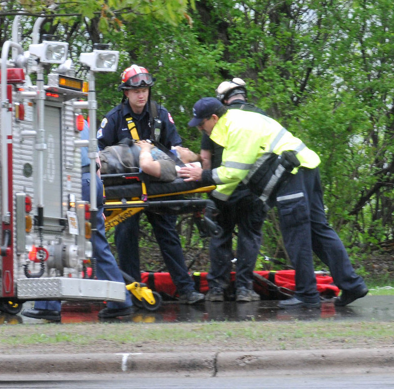 . Emergency workers treat one of the injured near Lilydale Regional Park in St. Paul on Wednesday. (Pioneer Press: John Doman)