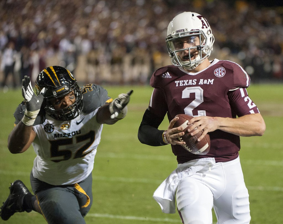 """. <p>9. JOHNNY MANZIEL <p>He�ll be Johnny Bench for just two quarters thanks to NCAA�s gentle slap on his non-signing wrist. (1) <p><b><a href=\'http://espn.go.com/college-football/story/_/id/9609389/johnny-manziel-texas-aggies-suspended-1st-half-season-opener-rice-owls\' target=\""""_blank\""""> HUH?</a></b> <p>    (AP Photo/Dave Einsel)"""