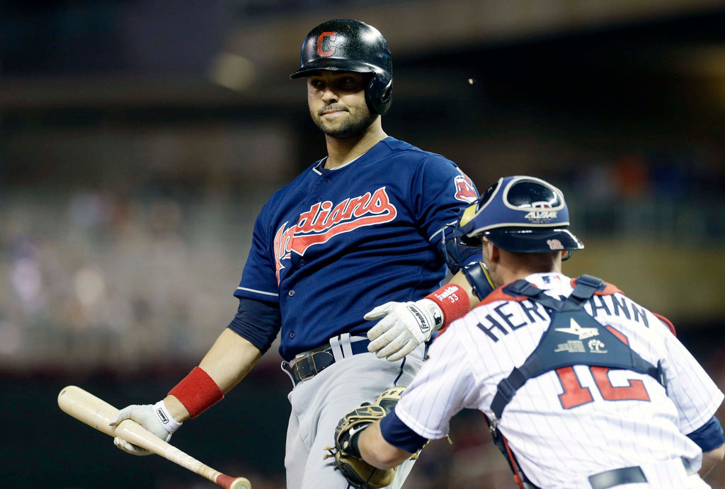 . Cleveland Indians\' Nick Swisher is tagged by Minnesota Twins catcher Chris Herrmann after striking out in the ninth inning. (AP Photo/Jim Mone)
