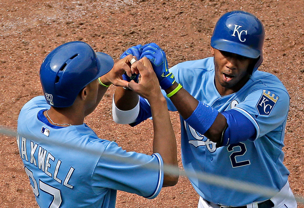 . Kansas City Royals\' Alcides Escobar (2) and Justin Maxwell (27) celebrate after Escobar hit a two-run home run during the seventh inning. (AP Photo/Charlie Riedel)