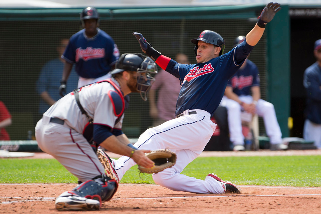 . Catcher Ryan Doumit of the Minnesota Twins waits for the throw as Asdrubal Cabrera of the Cleveland Indians is safe at home during the seventh inning. (Photo by Jason Miller/Getty Images)