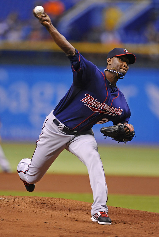 . Tampa Bay Rays starting pitcher Roberto Hernandez delivers to the Minnesota Twins during the first inning of a baseball game Monday, July 8, 2013, in St. Petersburg, Fla. (AP Photo/Brian Blanco)