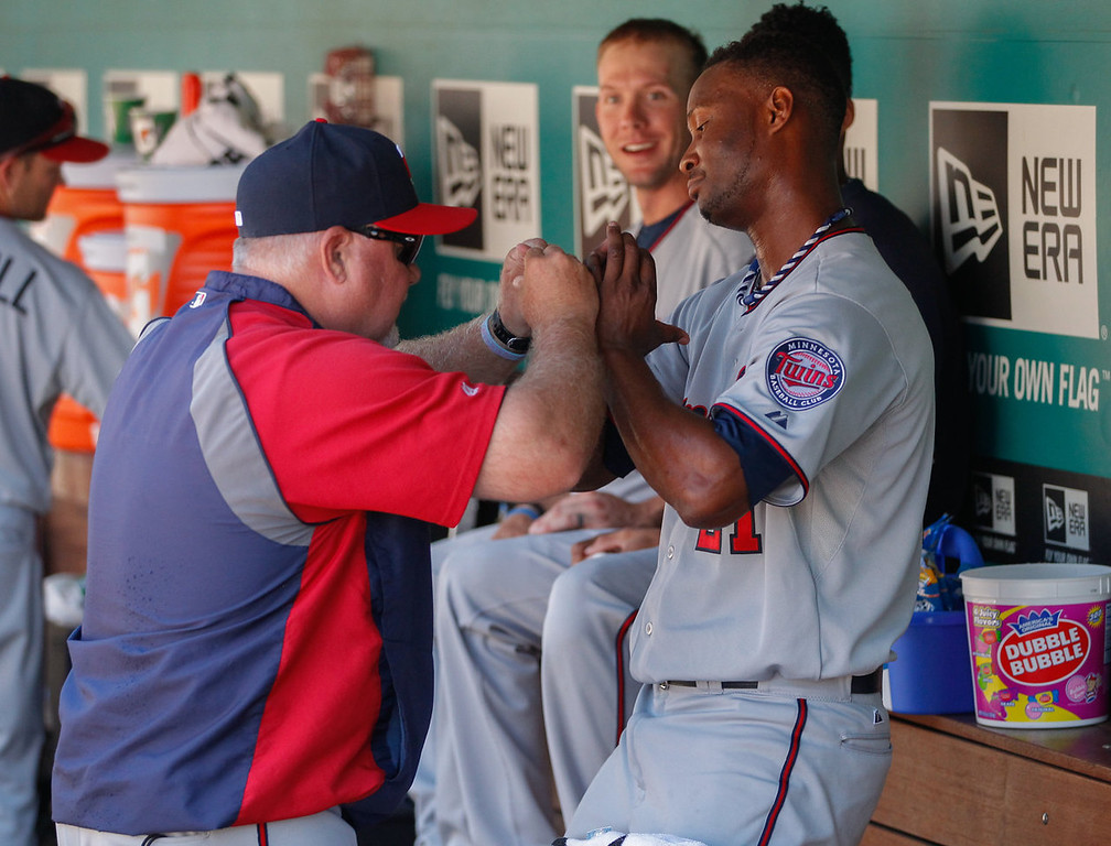. Starting pitcher Samuel Deduno of the Minnesota Twins is congratulated by manager Ron Gardenhire after coming out of the game in the seventh inning without yielding any runs against the Seattle Mariners. (Photo by Otto Greule Jr/Getty Images)