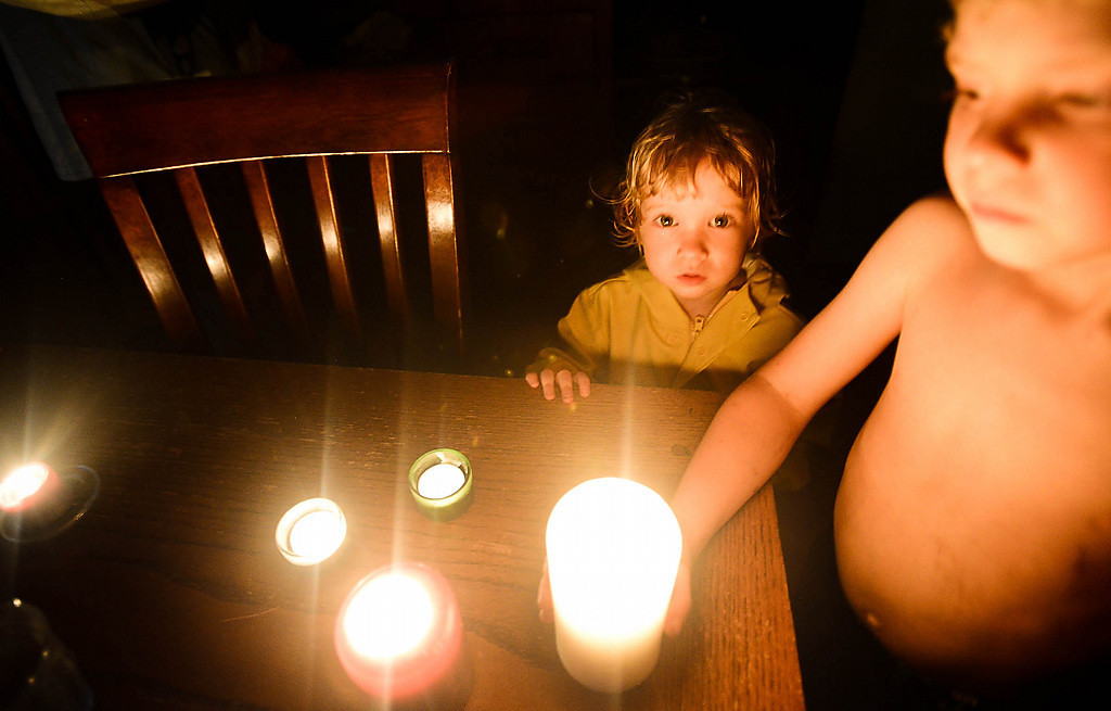 . Candles lit up dark homes across the Twin Cities as seen here at the home of Pioneer Press photographer Ben Garvin. Bailey Garvin, 2, and her brother Lewis, 5, gather around the table. (Pioneer Press: Ben Garvin)