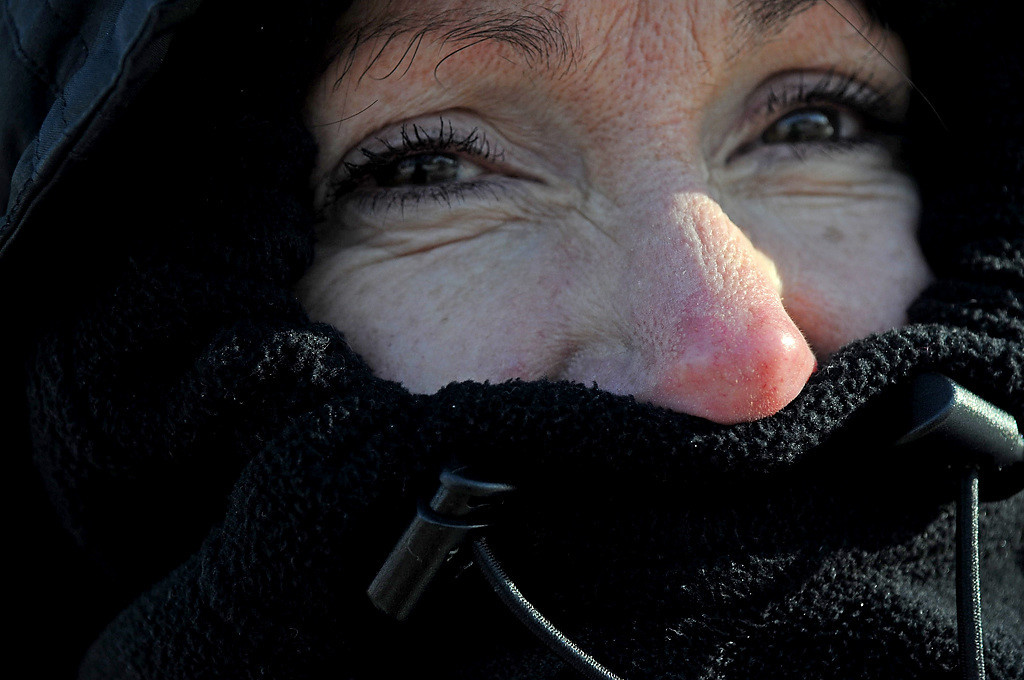 . Nancy Wistl\'s nose turned red while watching the Winter Carnival Grande Day Parade in St. Paul, Saturday January 25, 2014. She is from Maplewood. (Pioneer Press: Jean Pieri)