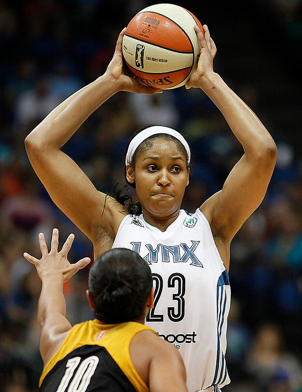 . Minnesota Lynx forward Maya Moore (23) looks to make a pass against Tulsa Shock guard Angel Goodrich (10 ) in the second half. (AP Photo/Stacy Bengs)