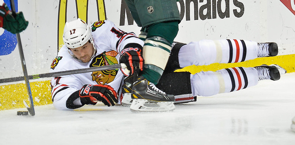 . Chicago Blackhawks defenseman Sheldon Brookbank reaches for the puck in the second period. (Pioneer Press: Ben Garvin)