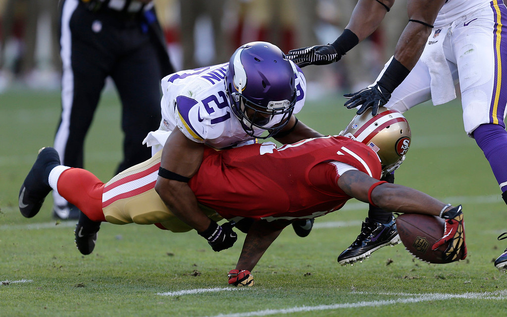 . Vikings cornerback Josh Robinson tackles 49ers wide receiver Quinton Patton during the second quarter. (AP Photo/Ben Margot)