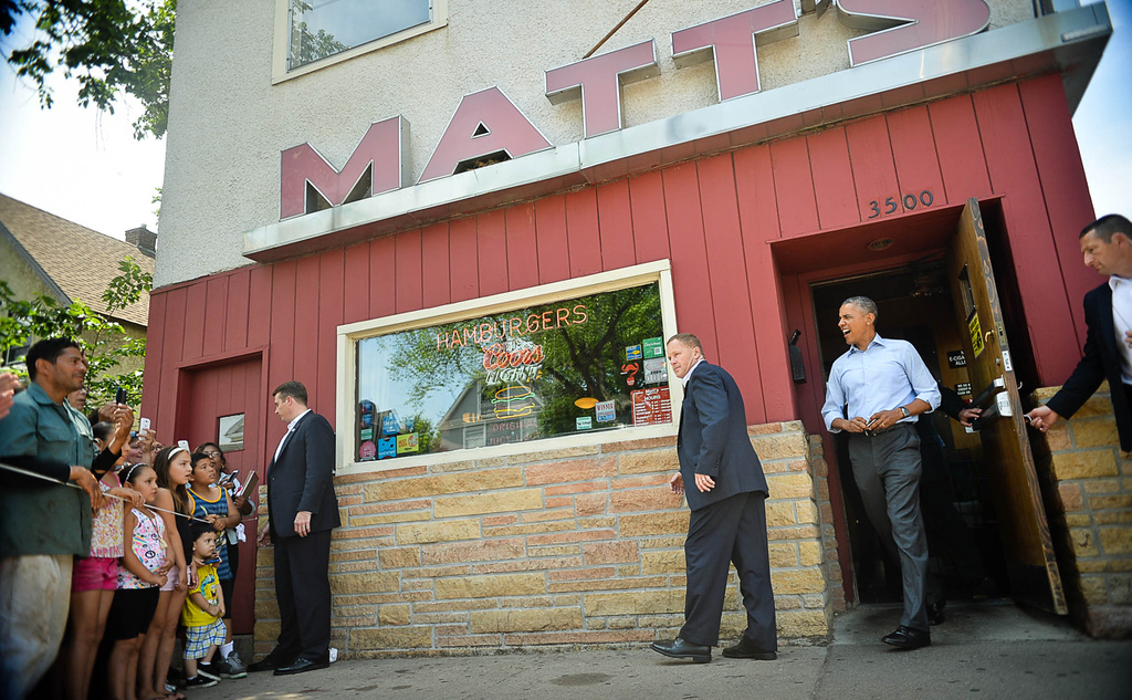 . With a belly fully of Jucy Lucy at Matt\'s Bar in Minneapolis,  President Barack Obama heds to Minnehaha Park for a town hall meeting on Thursday. (Pioneer Press: Ben Garvin)