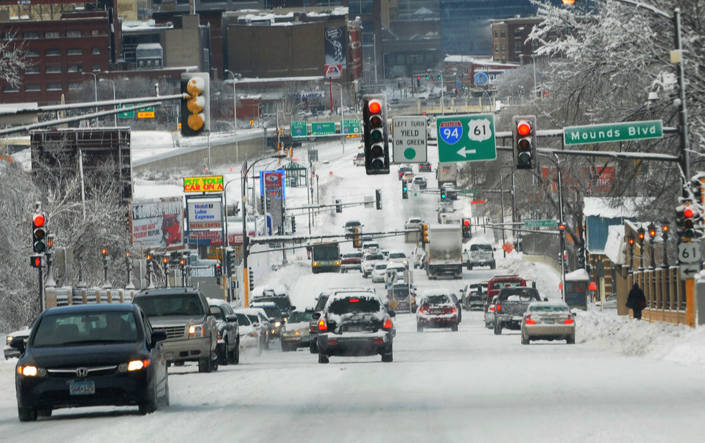 . Many cars had trouble getting up an icy East Seventh Street in St. Paul Friday. (Pioneer Press: Jean Pieri)