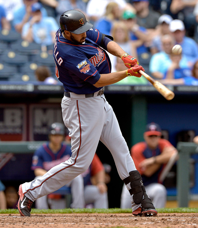 . The Minnesota Twins\' Chris Colabello (20) connects on an RBI single in the fifth inning. (John Sleezer/Kansas City Star/MCT)