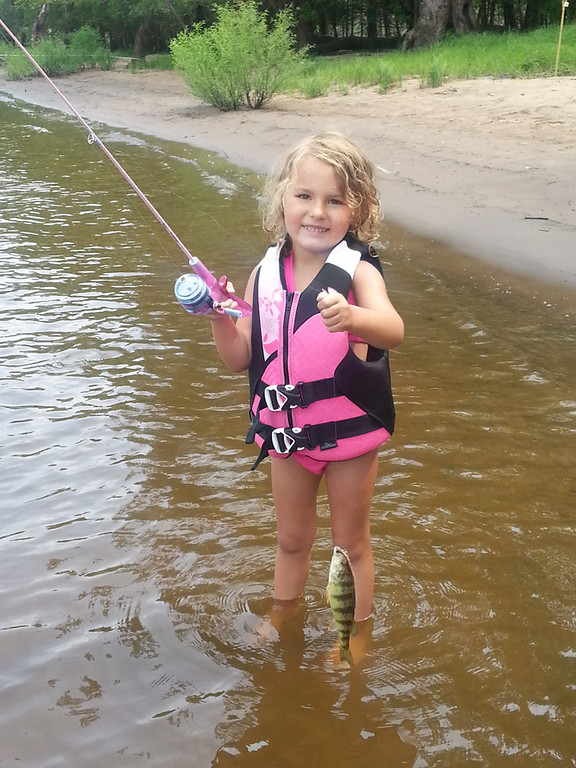 . Avery Jane Axel, 5, of Stillwater, caught her first fish Aug. 1 on the St. Croix River using a night crawler and her Disney princess fishing pole. She caught her second fish shortly after. (Courtesy Jill Rogness)