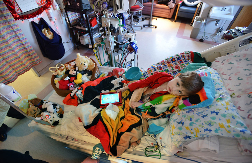 . Weary Cameron Ulrich holds forth in his room in the cardiovascular intensive care wing of St. Mary\'s Hospital in Rochester. Born with a congenital heart defect, Cameron had a heart transplant in May after waiting over six months.  (Pioneer Press: Richard Marshall)