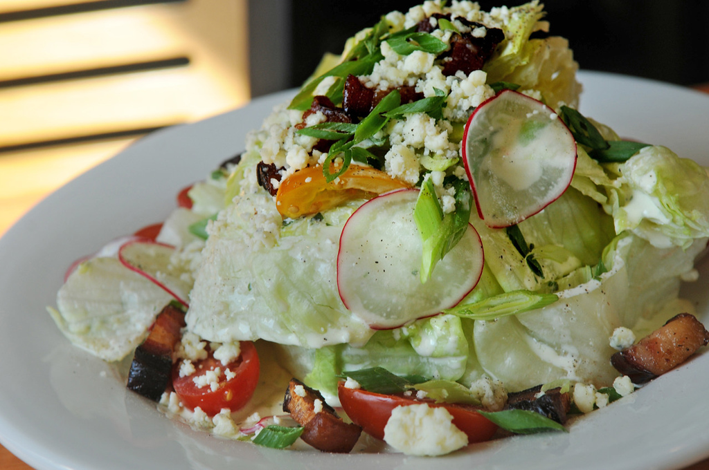. The Iceberg Stack Salad includes bleu cheese crumble, tomato, red onion and Fischer Farms bacon with buttermilk dressing. (Pioneer Press: Jean Pieri)