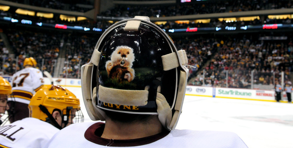 . Minnesota Gopher goaltender Ryan Coyne gopher helmet while on the bench during the first period during the WCHA Final Five semifinals at the Xcel Energy Center Arena on Friday, March 22, 2013. (Pioneer Press: Sherri LaRose-Chiglo)