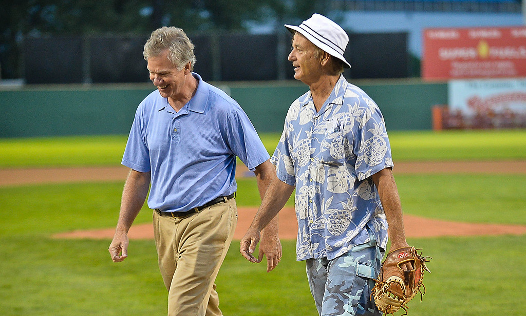. St. Paul Mayor Chris Coleman walks off the field with Bill Murray. (Pioneer Press: Ben Garvin)