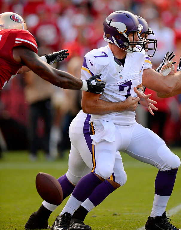 . Vikings quarterback Christian Ponder fumbles the ball in the first quarter against the 49ers. The ball was recovered by San Francisco\'s  Aldon Smith. (Photo by Thearon W. Henderson/Getty Images)