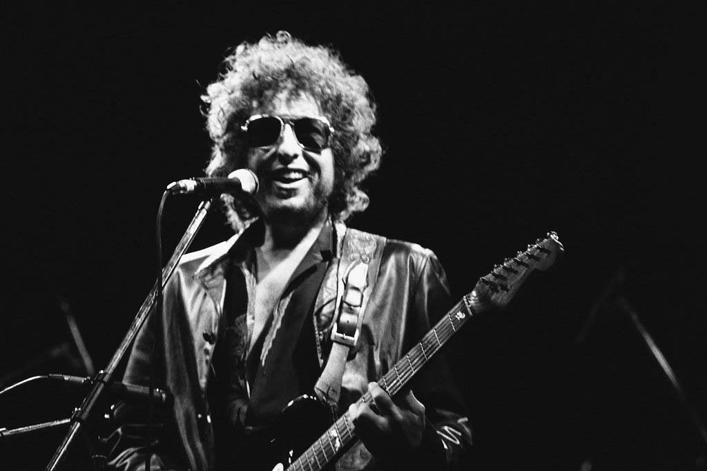 . 1981: Bob Dylan performs at the Colombes Olympic stadium, west of Paris, in front of an estimated crowd of 40,000, on June 24, 1981. (AP Photo/Herve Merliac)