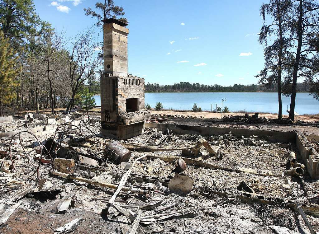 . The remains of a home on Sand Lake near Barnes, Wis. (Associated Press/Duluth News-Tribune, Bob King)