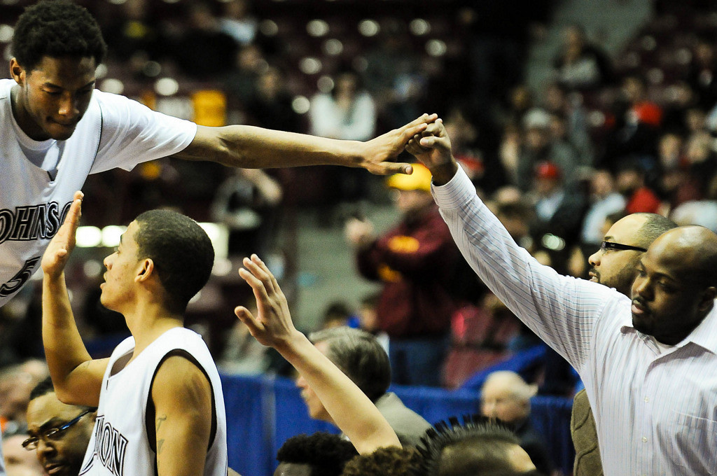 . St. Paul Johnson\'s Quashingm Smith-Pugh, left, is greeted by a fan as he leaves the game. (Pioneer Press: Ben Garvin)