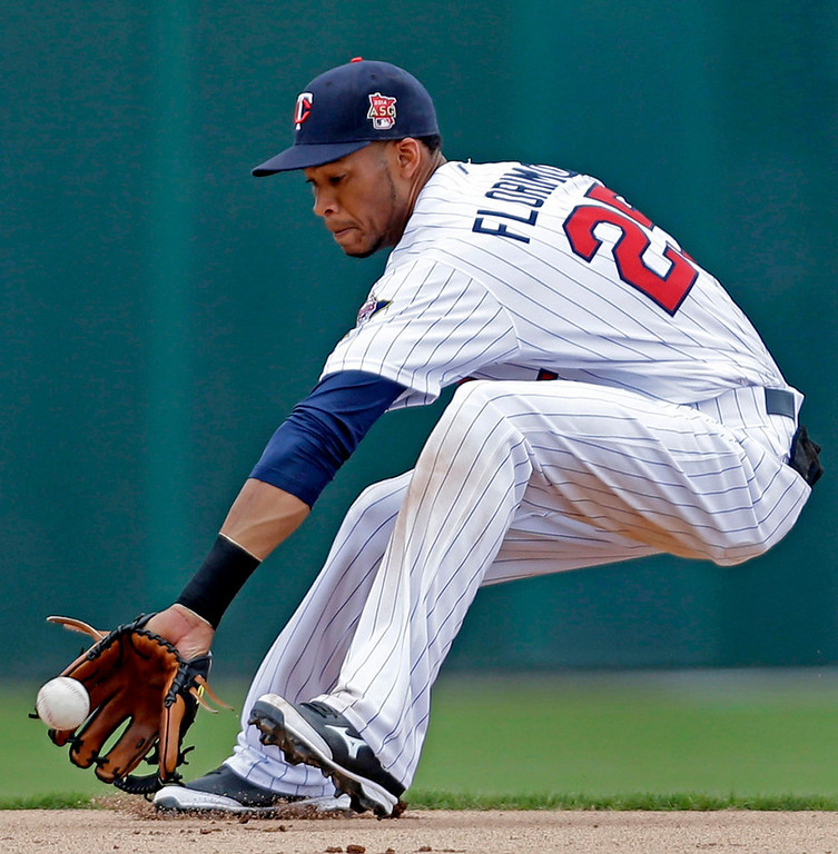 . Twins shortstop Pedro Florimon picks a grounder by Boston\'s Will Middlebrooks in the third inning. (AP Photo/Gerald Herbert)