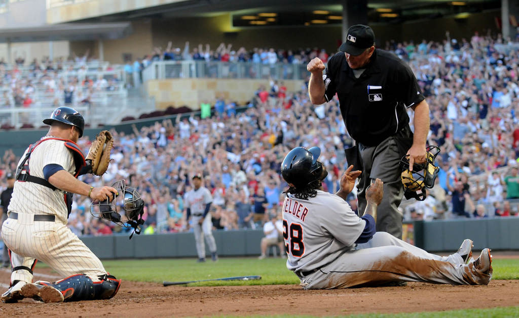 . Home plate umpire Bob Davidson calls the Detroit Tigers\' Prince Fielder out as Minnesota Twins catcher Ryan Doumit turns to get up after the tag during the sixth inning. (Pioneer Press: Sherri LaRose-Chiglo)