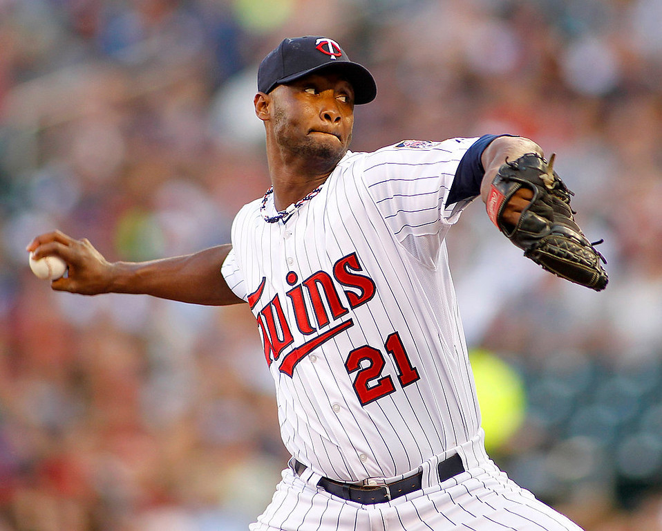 . Minnesota Twins starting pitcher Samuel Deduno throws in the first inning. (AP Photo/Andy Clayton-King)