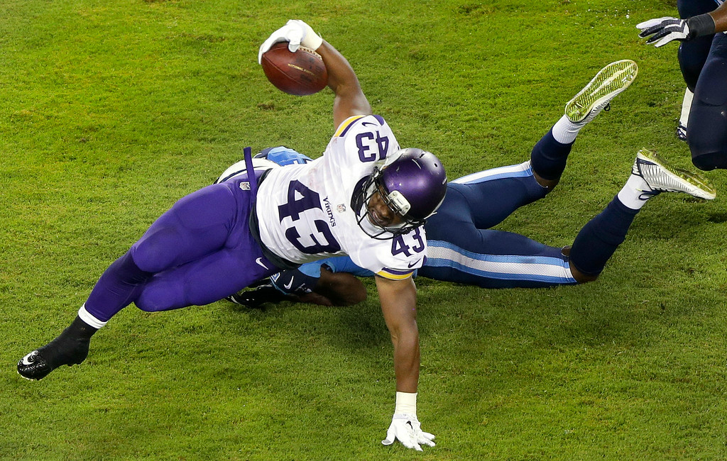 . Minnesota Vikings running back Dominique Williams is brought down by Tennessee Titans defensive back Tommie Campbell in the third quarter. (AP Photo/Wade Payne)