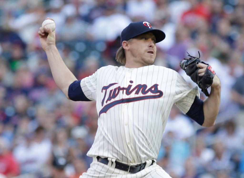 . Minnesota Twins pitcher Kevin Correia  throws in the first. (AP Photo/Jim Mone)