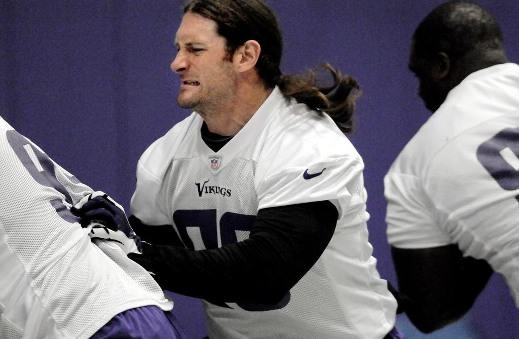 . Vikings defensive end Brian Robison bumps into teammates during a drill. (Pioneer Press: Jean Pieri)