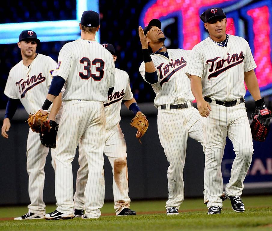 . Twins first baseman Justin Morneau (33) celebrates the victory with, left to right, Trevor Plouffe, Pedro Florimon and Oswaldo Arcia. (Pioneer Press: Sherri LaRose-Chiglo)