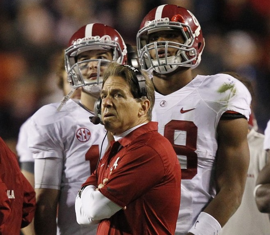 ". <p><b> Alabama�s dreams of a third consecutive national championship suffered a crippling blow Saturday when coach Nick Saban decided to do this in the fourth quarter of the Iron Bowl � </b> <p> A. Try a 57-yard field goal with a new kicker <p> B. Gamble on several fourth downs <p> C. Drink heavily <p><b><a href=\'http://www.twincities.com/sports/ci_24633078/iron-bowl-alabama-auburn-thriller-will-take-while\' target=""_blank\"">HUH?</a></b> <p>    (AP Photo/Butch Dill)"