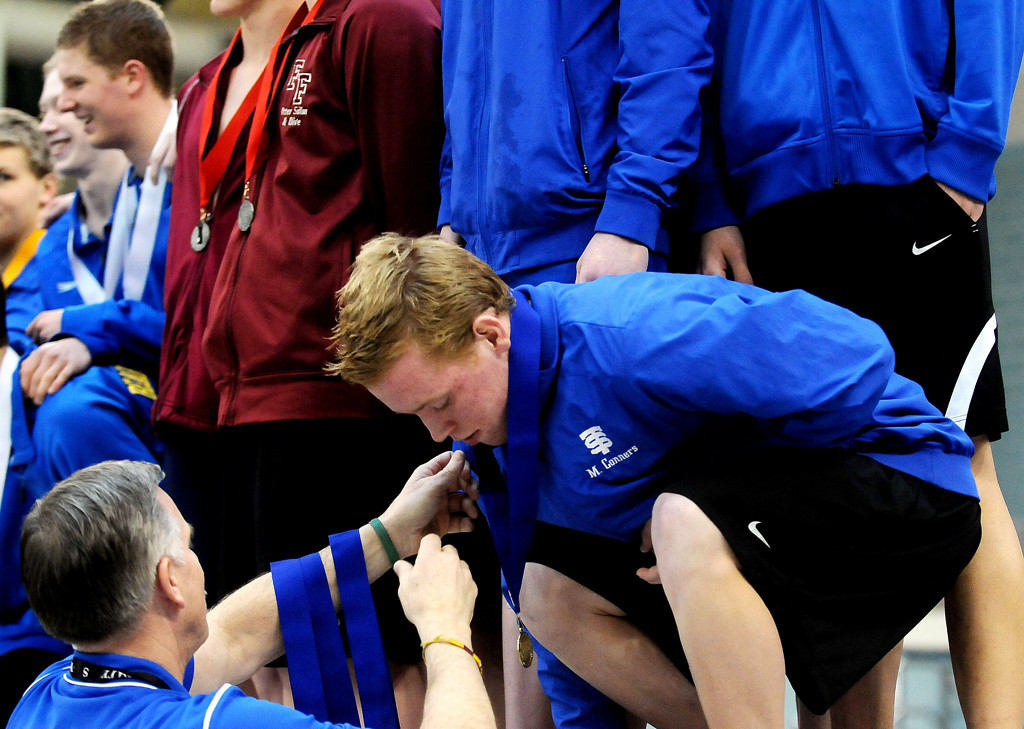 . St. Thomas Academy\'s Michael Conners receives his first place medal with his teammates. (Pioneer Press: Sherri LaRose-Chiglo)