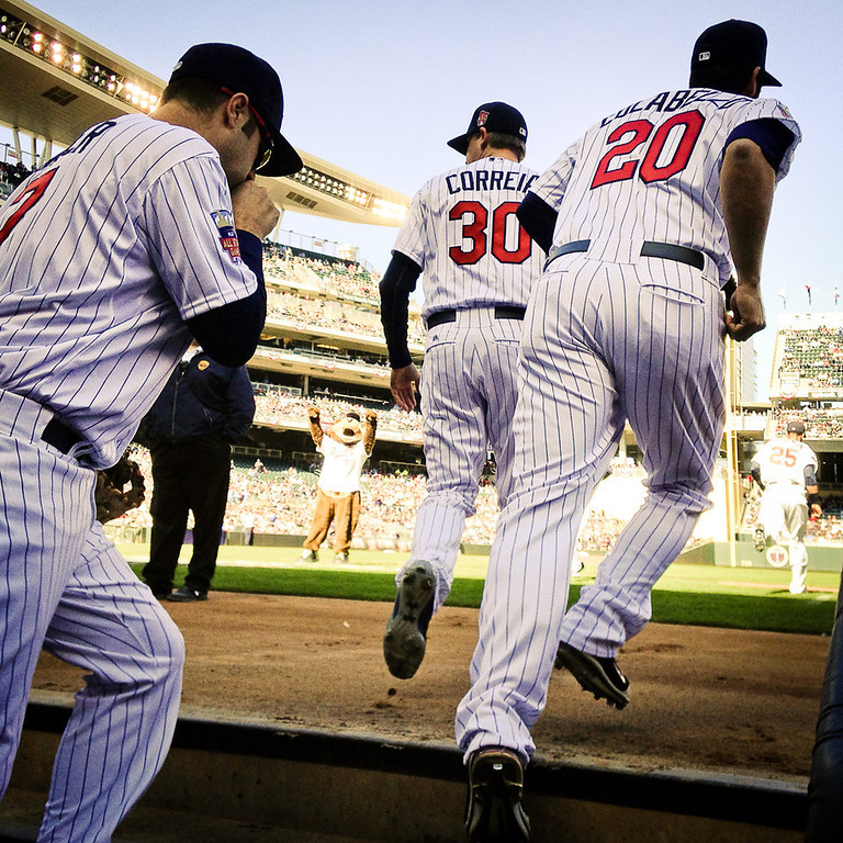. Minnesota\'s Joe Mauer, Kevin Correia and Chris Colabello head out onto the field to open the sseason against the Oakland Athletics. (Pioneer Press: Ben Garvin)