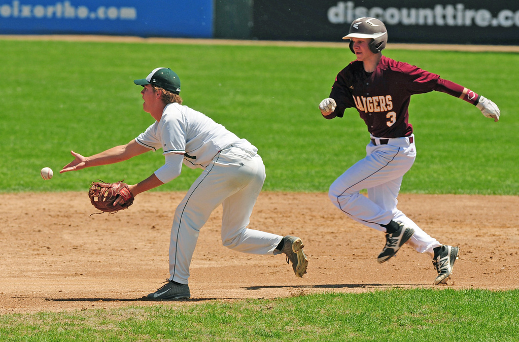 . Forest Lake\'s Dylan Dresel, right, is forced out at second base by Mounds View shortstop Mitch Fredrickson, who flips the ball to second base in the third inning.  (Pioneer Press: Scott Takushi)